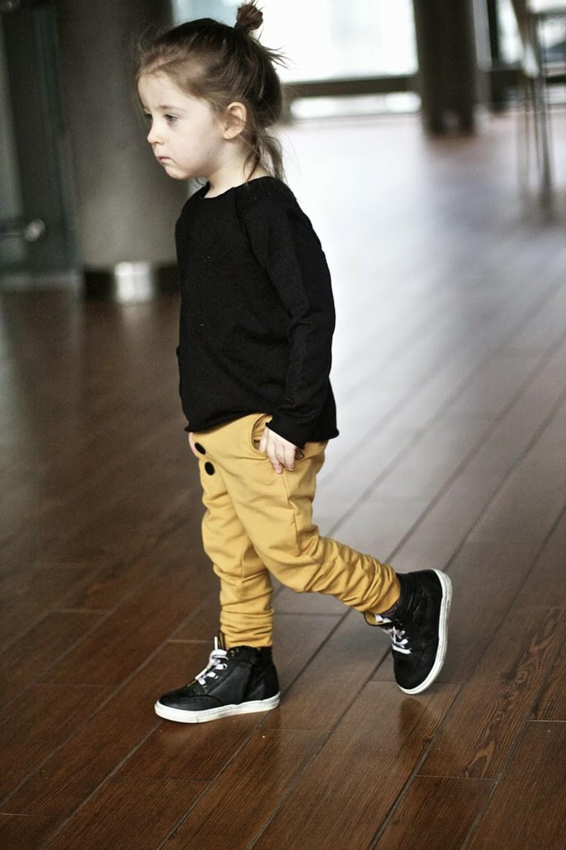 A toddler male bun style.