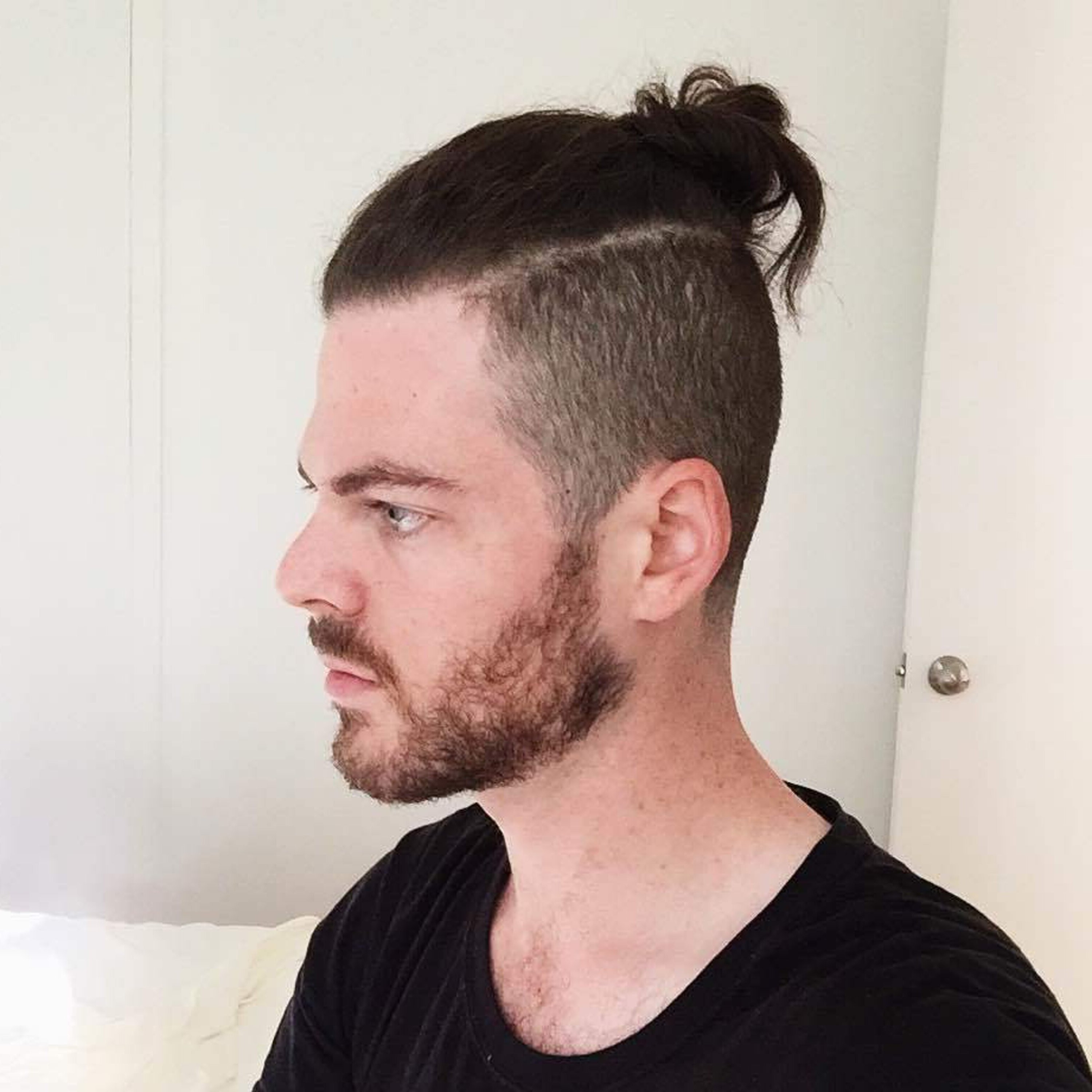 An ugly male bun hairstyle.