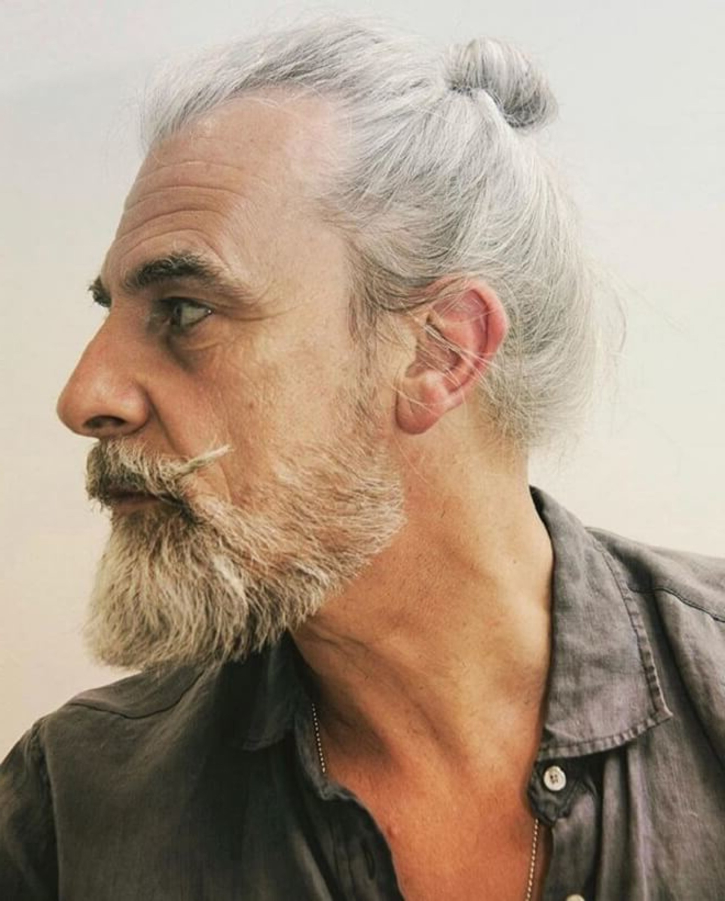 A male haircut with a bun for white haired men.